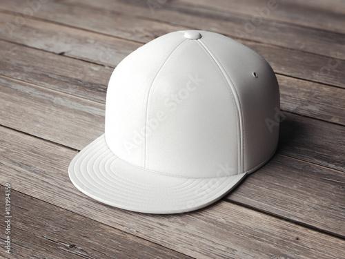 Fotografia  White snapback on the wooden floor. 3d rendering