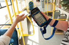 Human Hand Holding Plastic Cards. Passenger Pays For Fare In Public Transport. Payment Terminal, Credit Card Reader, Sales Concept.