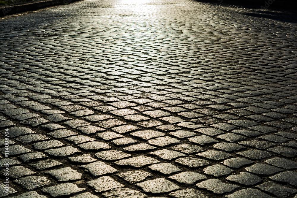 Fototapety, obrazy: sunlight on cobblestone road. old stone texture