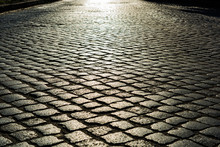 Sunlight On Cobblestone Road. Old Stone Texture