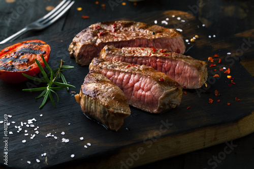 Fotografia, Obraz  Sliced medium rare grilled  Steak Ribeye with rosemary