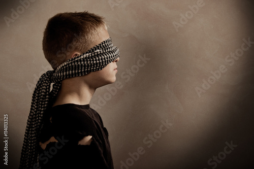 Fotografie, Obraz  Serious boy blindfolded with copy space in front