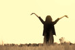 Vintage photo of teenage girl enjoy with sunshine in wheat field
