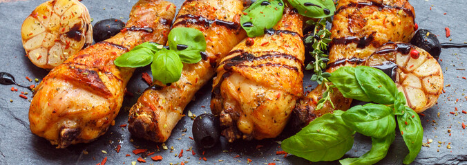 Baked chicken with garlic, pink pepper and Basil