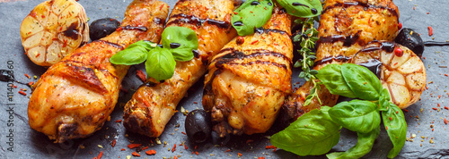 Keuken foto achterwand Kip Baked chicken with garlic, pink pepper and Basil