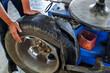 Mechanic changing burst tire