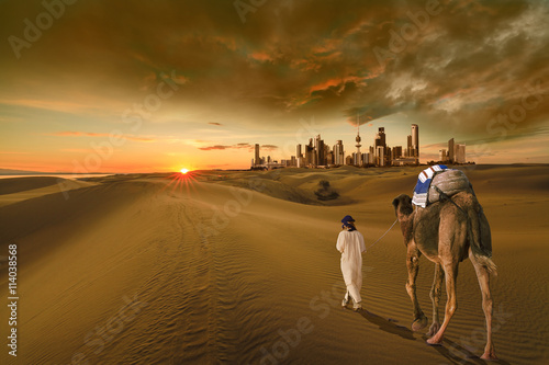 Spoed Fotobehang Kameel A man with a camel walking in the middle of the desert towards the kuwait city