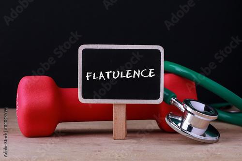 Valokuvatapetti Medical concept - Stethoscope and dumbbell on wood with Flatulence word