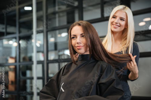 Fotografie, Obraz  Hairdresser giving a new haircut to female customer at parlor