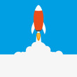 The rocket flies takeoff blue background white smoke
