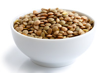 White Ceramic Bowl Of Green Uncooked Lentils Isolated On White I