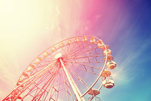 Vintage Toned Picture Of A Ferris Wheel At Sunset