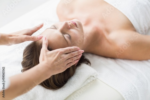 Cropped hands of therapist performing reiki on woman Canvas Print