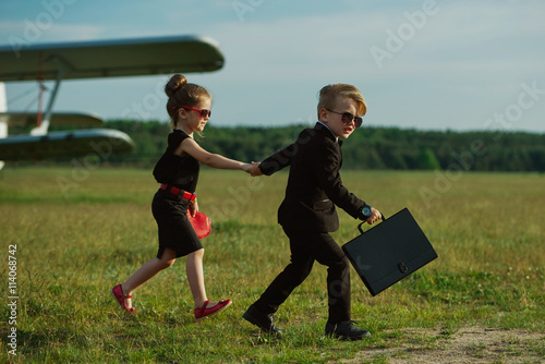 фотография  young boy and girl playing spy