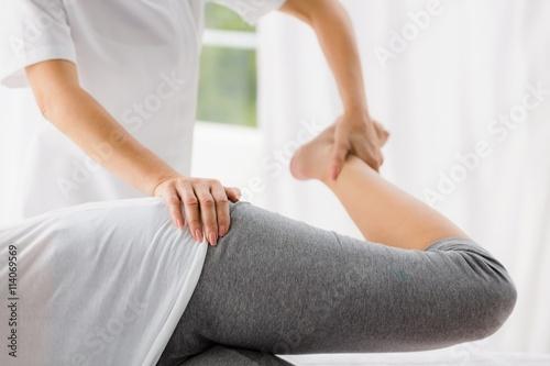 Masseur stretching woman Wallpaper Mural