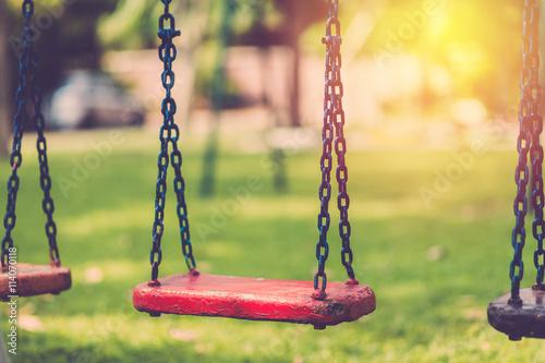 Empty chain swing in children playgriund. Vintage filter