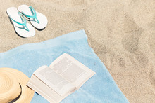 A Relaxed Day On The Beach With A Book