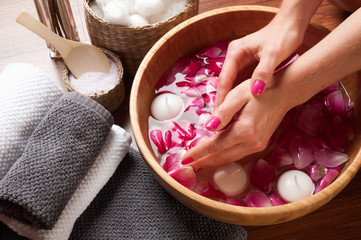 Hands spa, beautiful woman's hands in bowl of water