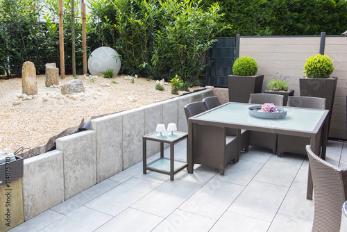 new arranged stone garden with terrace and Table and chairs Fototapeta