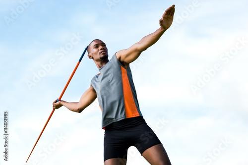 Spoed Foto op Canvas Gymnastiek Composite image of athlete man throwing a javelin
