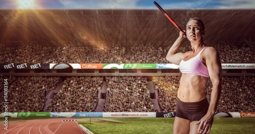 obraz lub plakat Composite image of female athlete throwing a javelin