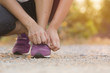 Woman with athletic legs on jog or run on trail in park