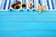 Summer beach background border, starfish, sunglasses, blue wood
