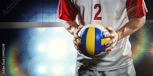 Composite image of sportsman holding a volleyball Canvas Print