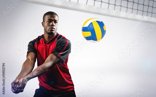 Composite image of sportsman playing volleyball Canvas Print