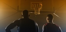 Two Basketball Player Looking The Basketball Hoop