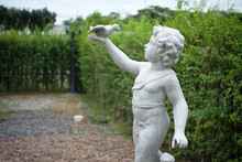 Old Mable Statue Of A Child With A Bird