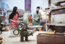 Elephant Sculpture On Table With Artists Working
