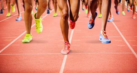 Fototapeta Composite image of close up of sportsman legs running