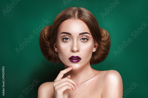 Attractive mysterious young woman with double hair bun in Princess Leia hairstyl Wallpaper Mural