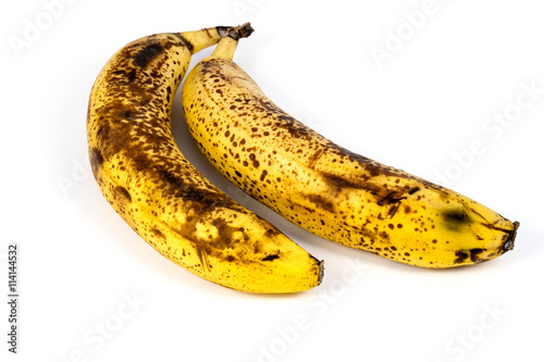 Fényképezés Two overripe bananas isolated on white background