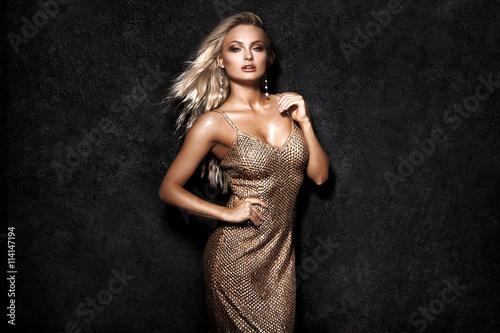 Obraz na plátně  Beautiful sexy blonde woman on black background, party.