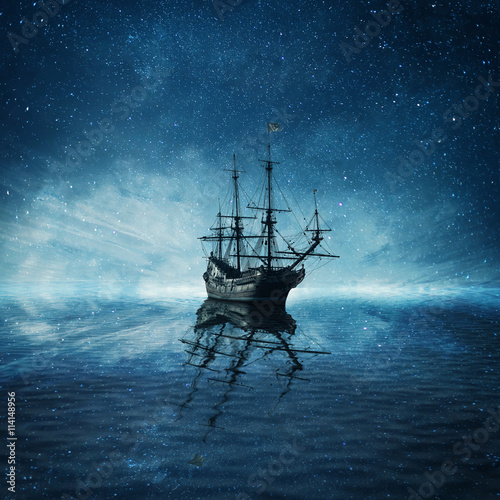 Tuinposter Schipbreuk A ghost pirate ship floating on a cold dark blue sea landscape with a starry night sky background and water reflection.