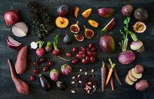 Different Purple Fruit And Vegetables On Dark Background