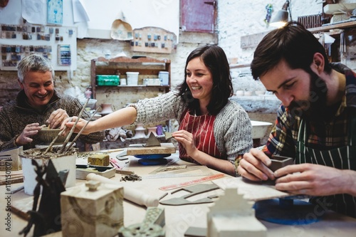 Happy potters working at workshop