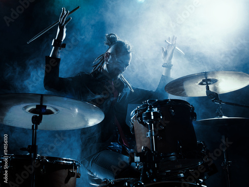 Photo Silhouette of the drummer on stage.
