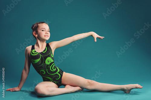 Tuinposter Gymnastiek little girl acrobat. exercises. fitness