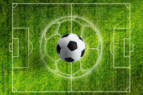 Soccer ball on green grass stadium with white layout - 114158543