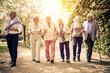 Leinwandbild Motiv Group of old people walking outdoor
