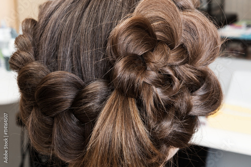 Fotografie, Obraz  weave beautiful braids in hairdressing salon