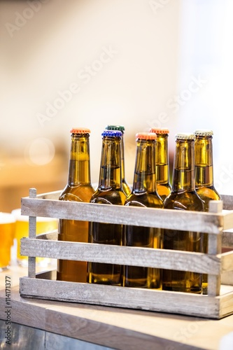 Fotografering  Close-up of beer bottles in crate