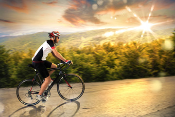 FototapetaCyclist at sunset