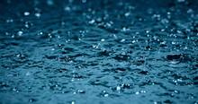 Heavy Rain Water Drops On Surface Street