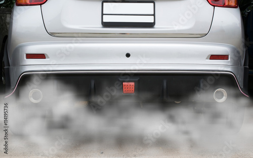 Photo  combustion fumes coming out of car exhaust pipe