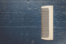 Handmade Wooden Comb On The Bl...