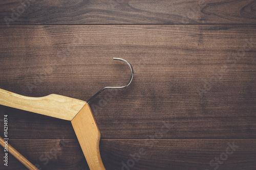 Obraz na plátně clothing hanger on the brown wooden table